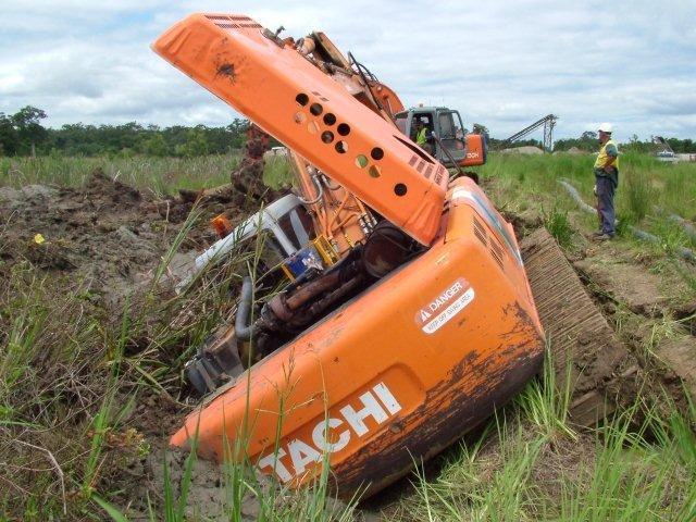 More Mud Wrestling Excavators