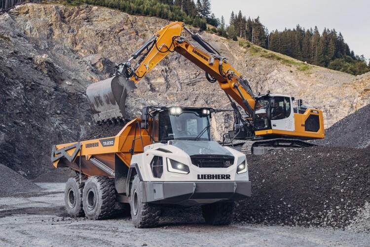 Liebherr TA 230 articulated dump truck with R930 excavator
