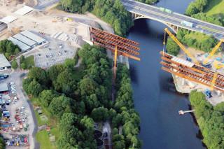 Sarens' 1,200 tonne capacity Gottwald crane installs the Lune West Bridge beams.